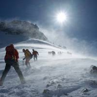 Time's up: 100 kph winds on Mount Aka force climbers to descend the mountain. | OSCAR BOYD