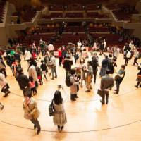 Stage directions: People wander the stage at Suntory Hall at an open house event in 2016.   © SUNTORY HALL