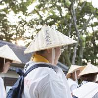 Dressed for the part: people of all ages attempt the Shikoku Pilgrimage wearing the pilgrim's sedge hat and white coat. | CHRISTINA SJOGREN