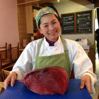 Prime cut: Yoshimi Hayakawa shows off a cut of tuna, ready to be prepared and served as maki-zushi (sushi rolls) and nigiri-zushi (hand pressed sushi) at Wa Cafe in Galway, Ireland. | MICHAEL DILLON