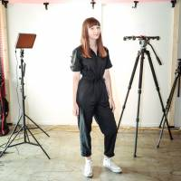 Travelin' woman:  Emma Felice stands in the Tokyo Creative studios in Shibuya Ward. The 23-year-old has a YouTube channel called Tokidoki Traveler and hosts Tokyo Creative Play, which is part of the Tokyo Creative agency's branded sites. | ELLE HARRIS