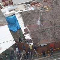 Misunderstood: This aerial photo shows a house in the city of Neyagawa, Osaka, where a couple allegedly confined their 33-year-old daughter, who died last month. | KYODO