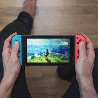 Make the switch: Learners of  Japanese, why not try offsetting the guilt of cheating at video games by  changing your Nintendo Switch's settings to Nihongo and checking Japanese online walkthrough guides? | GETTY IMAGES