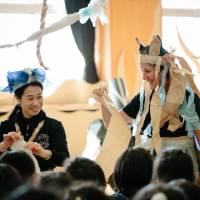 Play for Tohoku: Acchi Cocchi's Mikako Atsuchi (left)and a member of  Polyglot Theatre visit a school in Minamisanriku, Miyagi Prefecture, last month. | AI UEDA