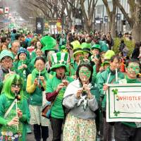 Everything's gone green: Japanese take to St. Patrick's Day festivities with characteristic enthusiasm in the parade held every year along the Omotesando shopping street in Tokyo. | YOSHIAKI MIURA