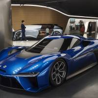 A NIO EP9 autonomous electric vehicle is displayed at the NIO House in Beijing on Dec. 2.  The world's top producer of EVs, China aims to leapfrog its competitors in the race to develop connected and shared autonomous EVs.   BLOOMBERG