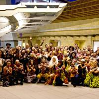 Wakandan delegation: Moviegoers assemble at Roppongi Hills in Tokyo on March 3 for a 'Black Panther' viewing party. | ALEKSANDER DRAGICEVIC