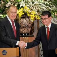 Foreign Minister Taro Kono shakes hands with Russian Foreign Minister Sergey Lavrov after a news conference following their meeting at Iikura Guest House in Tokyo on March 21. | REUTERS