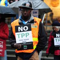Protesters gather outside a World Affairs Council meeting on the Trans Pacific Partnership in Portland, Oregon, on March 21, 2016. | ALEX MILAN TRACY/SIPA USA