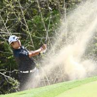Hideki Matsuyama hits out of a sand trap in the group stage at the Dell Technologies Match Play in Austin, Texas, on Wednesday. | KYODO