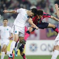 Cerezo Osaka's Yang Dong-hyun (center) heads the ball during his team's match against Buriram United in the Asian Champions League on Wednesday in Osaka. | KYODO