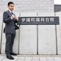 Former minimumweight world champion Katsunari Takayama poses for photos in front the Members' Office Building of the House of Councillors after his meeting with politician Seiko Hashimoto on Wednesday. | KAZ NAGATSUKA