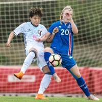 Japan's Yuika Sugasawa (left) and Iceland's Guony Árnadottir vie for the ball in an Algarve Cup match on Friday in Parchal, Portugal. | GETTY / VIA KYODO