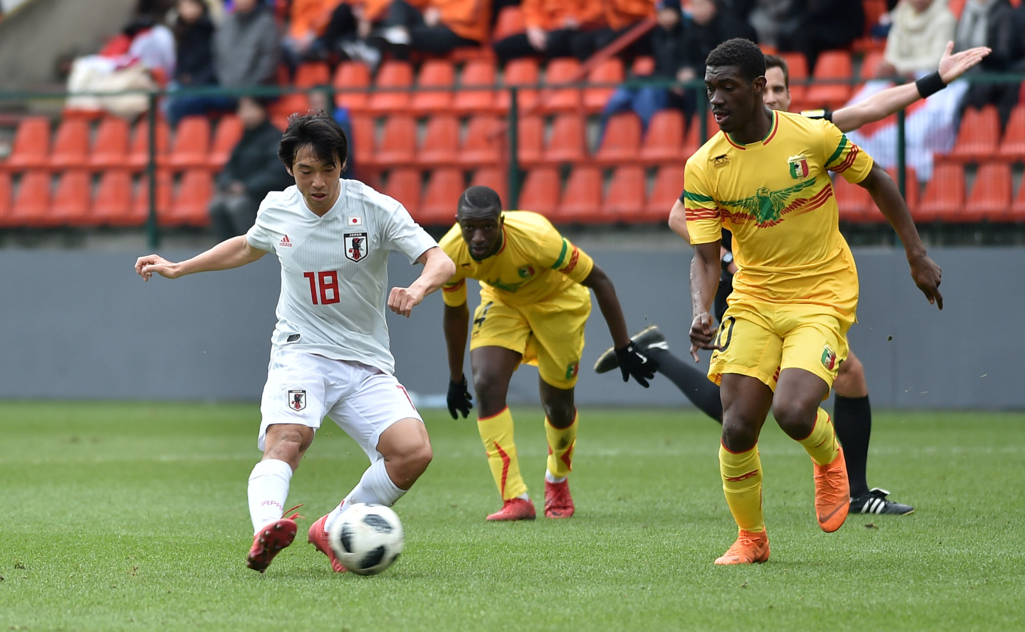 Japan's Shoya Nakajima takes a shot during an international friendly against Mali on Friday in Liege, Belgium. Nakajima scored a late equalizer in the 1-1 draw. | REUTERS