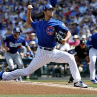 Chicago's Yu Darvish pitches during the Cubs' spring training game against the Dodgers on Tuesday in Mesa, Arizona. | AP