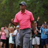 Tiger Woods pumps his fist after a birdie putt on the 10th hole during the third round of the Valspar Championships on Saturday. | USA TODAY / VIA REUTERS