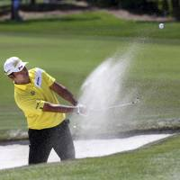 Hideki Matsuyama chips for a birdie from the bunker at the first green during the second day of the Arnold Palmer Invitational in Orlando, Florida, on Friday. | AP