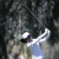 Ayako Uehara hits from the fairway on the ninth hole during the first round of the ANA Inspiration at Mission Hills Country Club on Thursday. | AP