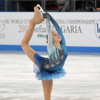 Russia's Alexandra Trusova made history at the world junior championships on Saturday night by landing two quadruple jumps in her free skate. | KYODO