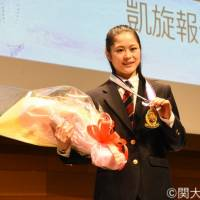 Satoko Miyahara, who finished fourth at the Pyeongchang Olympics, poses with the gold medal given to her by Kansai University president Keiji Shibai at a ceremony on March 8. | COURTESY PHOTO