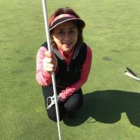 Emi Watanabe, Japan's first female world skating medalist, holds the pin after hitting a hole-in-one on March 14 at the Daiei Country Club in Chiba Prefecture. Watanabe, who captured the bronze medal at the 1979 worlds in Vienna, used a 7-iron on the 110-yard, 13th hole for her first ace. | EMI WATANABE