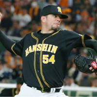 Tigers hurler Randy Messenger fires a pitch in Friday's season opener against the Giants at Tokyo Dome. Hanshin beat Yomiuri 5-1. | KYODO