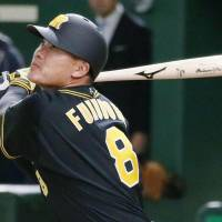 The Tigers' Kosuke Fukudome homers in the second inning on Friday night. | KYODO