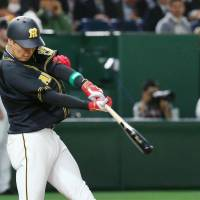 Hanshin's Yusuke Oyama homers in the third inning. | KYODO