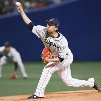Japan starter Kodai Senga pitches against Australia on Saturday night at Nagoya Dome. | KYODO