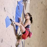 Veteran Akiyo Noguchi competes in the women's final at the lead climbing national championship in Kazo, Saitama Prefecture, on Sunday. | KAZ NAGATSUKA