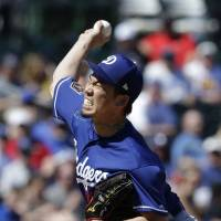 Dodgers starter Kenta Maeda pitches during a spring training game against the A's on March 20 in Oakland, California. | USA TODAY / VIA REUTERS