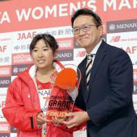 Hanami Sekine receives a trophy for qualifying for the Grand Championships, the qualifying race for Japanese runners for the 2020 Olympics, with a third-place finish at Sunday's Nagoya Women's Marathon.   KYODO