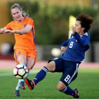 Desiree van Lunteren of the Netherlands (left) passes the ball ahead of Japan's Mana Iwabuchi during their game at the Algarve Cup in Parchal, Portugal, on Wednesday. | KYODO