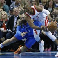 Houston's Chris Paul (right) and Oklahoma City's Steven Adams compete for the ball during the Rockets' 122-112 win on Tuesday. | AP