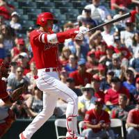 Shohei Ohtani bats during a spring training game against the Reds on March 12, in Tempe, Arizona. | AP