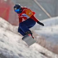 Gurimu Narita competes in the men's snowboard cross SB-LL2  competition at Jeongseon Alpine Centre during the Pyeonchang Paralympics on Monday. Narita earned bronze. | REUTERS