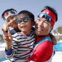 Yoshihiro Nitto celebrates with his two sons after winning silver in the men's cross-country 1.5-km sprint classical at the Pyeongchang Paralympics on Wednesday. | KYODO