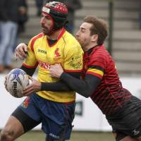 Spain's Mathieu Belie (left) carries the ball during his team's 18-10 defeat to Belgium on Sunday in the Rugby Europe Championship in Brussels. The result meant Romania qualifies for the 2019 Rugby World Cup. | AP