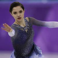 Olympic silver medalist Evgenia Medvedeva wil skip the world championships later this month. | AP