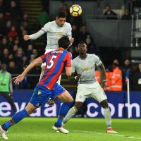 Manchester United's Chris Smalling heads the ball in for a goal against Crystal Palace in Premier League action at Selhurst Park on Monday night. | AFP-JIJI