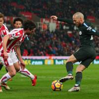 Manchester City's David Silva controls the ball on Monday against Stoke City.  Silva had a pair of goals in the visitors' 2-0 win. | REUTERS