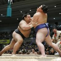 Takayasu  (left) overpowers Shodai on Tuesday at the Spring Grand Sumo Tournament  in Osaka. | KYODO