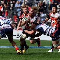 The Sunwolves' Willie Britz (center), seen in action against the Rebels last weekend in Tokyo, remains in the starting lineup for Saturday's Super Rugby match against the Sharks in Durban, South Africa. | AFP-JIJI