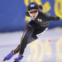 Miho Takagi competes during the women's 1,500-meter race during the World Cup speedskating finals on Sunday in Minsk. Takagi clinched the overall title on Sunday. | AP
