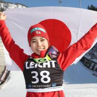 Ski jumper Sara Takanashi celebrates after capturing her record 54th World Cup victory with jumps of 100.5 and 96.5 meters on Saturday in Oberstdorf, Germany. | KYODO
