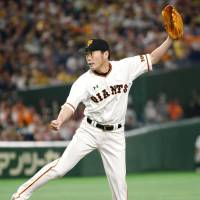 Koji Uehara, who made his pro debut with the Giants in 1999, pitches against the Tigers on Saturday afternoon at Tokyo Dome. The veteran right-hander made his last regular-season appearance for Yomiuri in 2008 before leaving for the major leagues. | KYODO