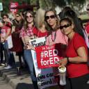 Teachers from Highland Arts Elementary School stage a final walk-in Wednesday in Mesa, Arizona. Communities and school districts are preparing for a historic statewide teacher walkout on Thursday that could keep hundreds of thousands of students out of school indefinitely.
