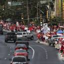 Hundreds of Red For Ed supporters line Broadway Boulevard near Granada in Tucson, Arizona, during a teacher walkout on Thursday.