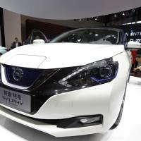 Global carmakers show off SUVs and electric models at Beijing auto show as China promises reforms