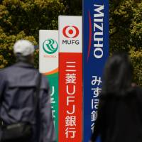 Banks rush to turn Japan cashless before legal change attracts tech giants